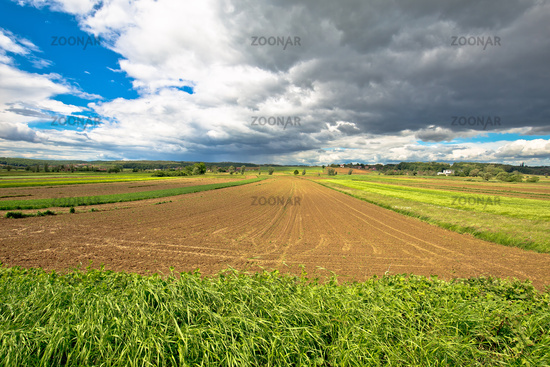 Agricultural landscape under dramatic sky view