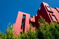 Low angle view on the building 'La Muralla Roja' by architect Ricardo Bofill in Calpe, Spain