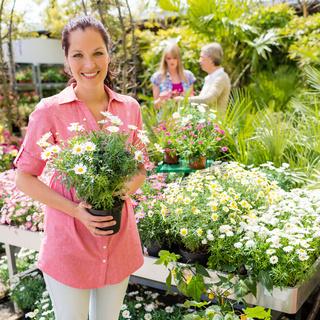 Woman shopping for flowers at garden center