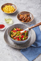 Quinoa with green beans, tomatoes, fried champignons, corn, red bell peppers, peas and soybeans. Healthy Vegetable Mix