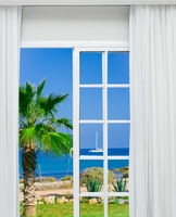 tropical paradise from an open door at home