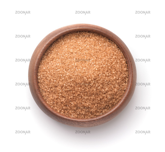 Top view of natural brown cane sugar in wooden bowl