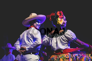Close up of a Catrina couple at public dance performance with traditional Mexican costumes in Merida, Mexico