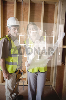 Architect and foreman checking the plans on white interface