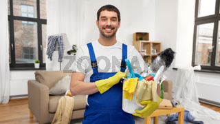 male cleaner with cleaning supplies at home