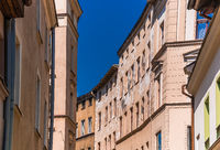 Low angle shot of old tenement buildings in Torun, Poland