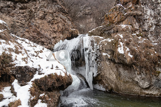 Partially frozen honey falls in January