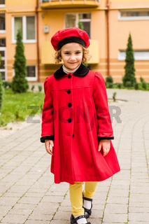 Girl portrait with outdoor playground at the background