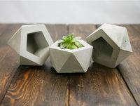 Hexagonal stone pot for flowers.