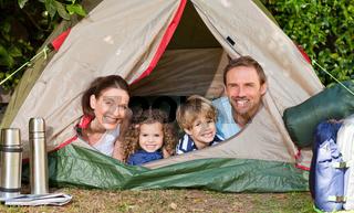 Joyful family camping in the garden