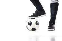 Soccer player stand on ball