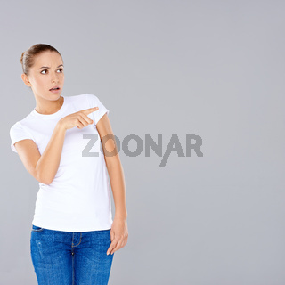 Woman pointing in disbelief
