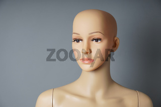 shop window mannequin or display dummy with bald head and naturalistic face