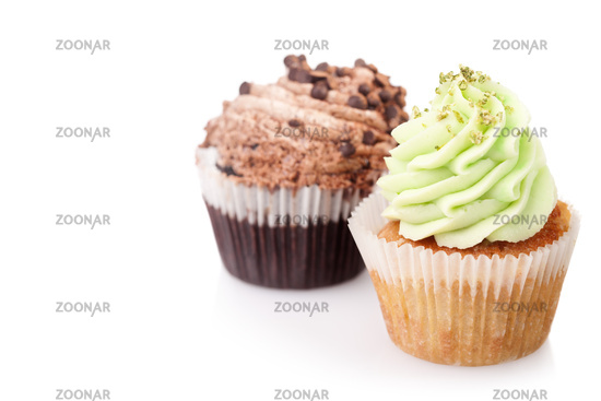 two cupcakes with cream isolated on white background with copyspace