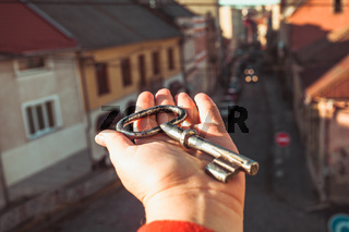 the key to the old city in a female hand