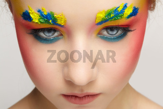 Close-up teenager girl face portrait with face art make-up . Paint on brows