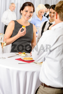 Business woman eat dessert from catering service