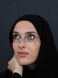 Portrait of modern young muslim woman in black abaya