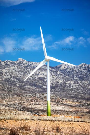 Wind power turbine under Velebit mountain view