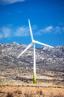 Wind power turbine under Velebit mountain view