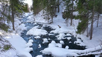 Small river in winter forest