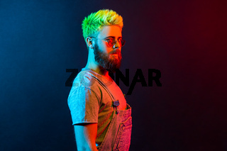 Hipster emotional man on colorful neon light background.