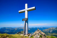 The cross on the summit of Les Hauts-Forts, a mountain of the Alps, border between Franc and Switzerland, Europe