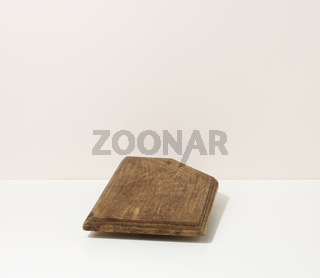 rectangular empty brown wooden kitchen board on a white table, utensils. Place to display food