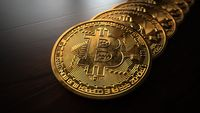 Golden bitcoins on the table