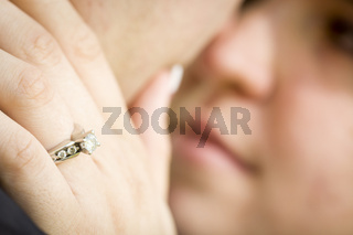 Female Hand with Engagement Ring Touching Fiance's Face