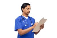 male doctor writing medical report on clipboard