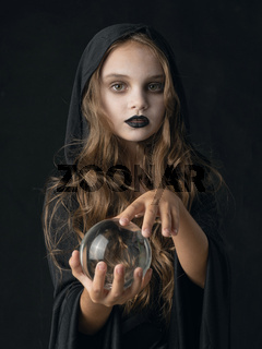 Halloween witch girl with crystal ball
