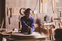Safety in woodworking. Female carpenter in googles and dust mask