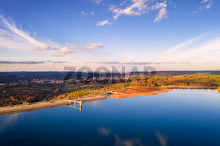 Drone aerial panoramic view of Sabugal Dam lake reservoir with perfect reflection, in Portugal