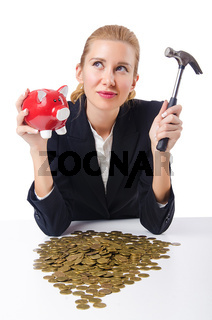 Woman trying to break the piggybank