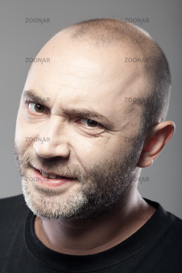 portrait of skeptical looking man isolated on gray background