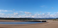 panoramic view of the beach at arnside with the leven railway viaduct and river in the south lakes area of cumbria