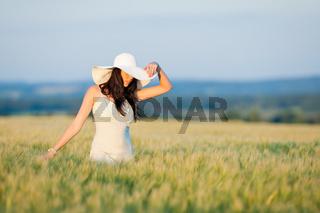 Sunset corn field beautiful brunette woman walk
