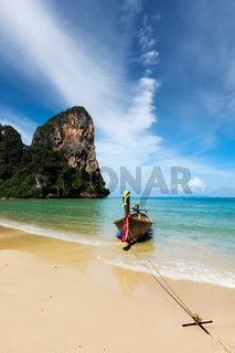 Long tail boat on tropical beach