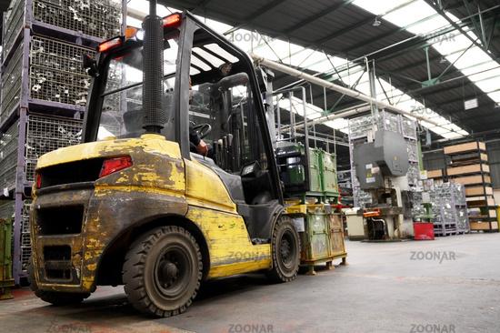 Forklift loader. Pallet stacker truck equipment at warehouse