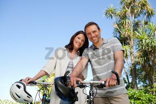 Joyful couple with their bikes