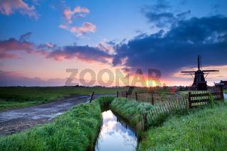 Dutch windmill at sunrise