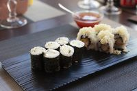 Traditional japanese rolls sushi with cucumbers and shrimps fried at restaurant