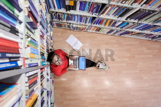 the students uses a notebook, laptop and a school library