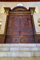 Wooden decorated entrance of historic Jewish Maimonides Synagogue with arched windows and chandelier, Cairo Egypt