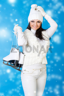 Beautiful woman in winter clothes with skates.