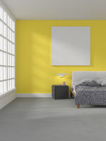 Modern grey bedroom with a bright yellow wall