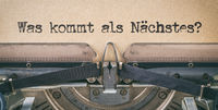 Text written with a vintage typewriter -  Whats new in german - Was kommt  als nächstes