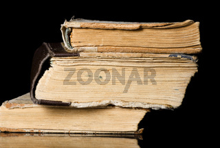Pile of old books on black