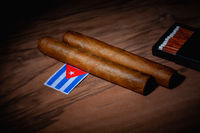 Luxury Cuban cigars and match bow on the wooden table